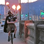 Unicyling Darth Vader Santa Claus Plays Flaming Bagpipes at Night
